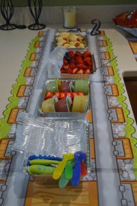 Train table runner with snacks.