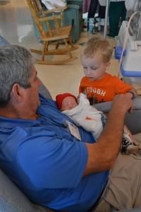 Papaw telling stories to Landon and Karson